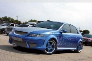 Chevrolet Lacetti, Nissan Almera Classic: Будь проще?